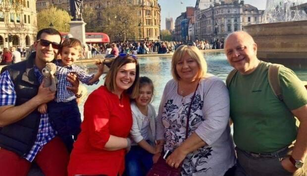 Allison Mejia's sister and brother-in-law, on the right, visited Mejia's family in the U.K. four years ago. It was the last time Mejia would see her sister. (Submitted by Allison Mejia - image credit)