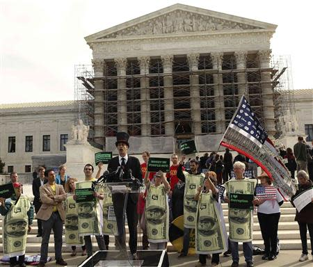 Protesters gather in front of the U.S. Supreme Court during a rally against large political donations in front of the US Supreme Court in Washington