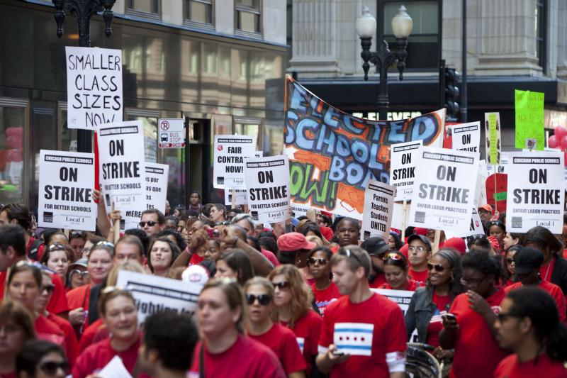 Thousands of public school teachers march on streets surrounding the Chicago Public Schools district headquarters on the first day of strike action over teachers' contracts on Monday, Sept. 10, 2012 in Chicago. For the first time in a quarter century, Chicago teachers walked out of the classroom Monday, taking a bitter contract dispute over evaluations and job security to the streets of the nation's third-largest city — and to a national audience — less than a week after most schools opened for fall. (AP Photo/Sitthixay Ditthavong)
