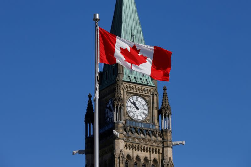FILE PHOTO: Canadian flag flies in front of the Peace Tower on Parliament Hill in Ottawa