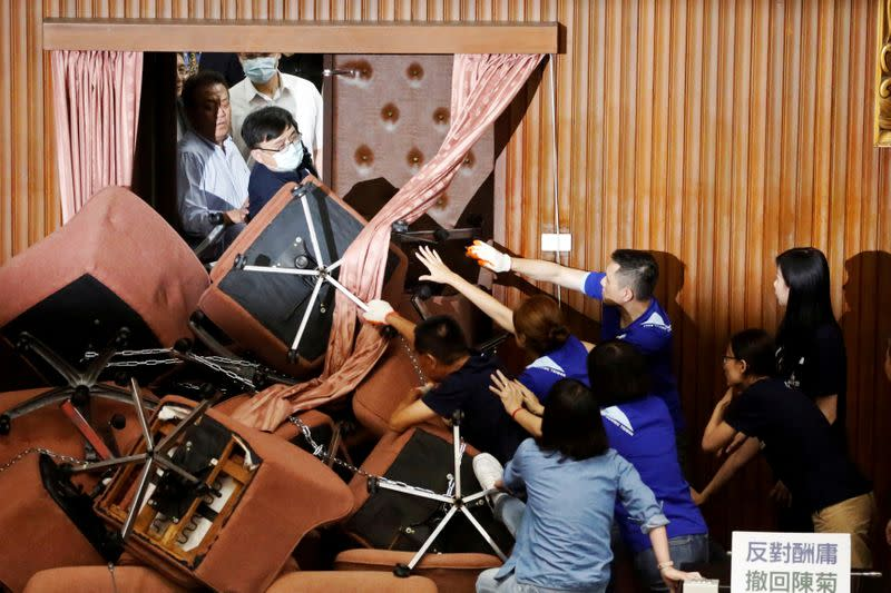 Lawmakers from Taiwan's ruling Democratic Progressive Party (DPP) scuffle with lawmakers from the main opposition Kuomintang (KMT) party, who have been occupying the Legislature Yuan, in Taipei