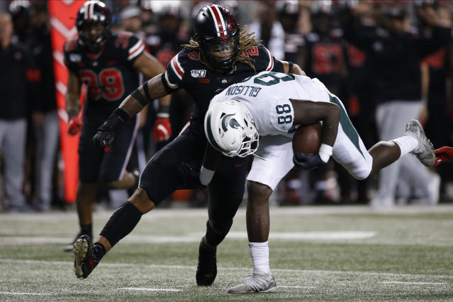 Ohio State defensive end Chase Young, left, tackles Michigan State tight end Trenton Gillison during the second half of an NCAA college football game Saturday, Oct. 5, 2019, in Columbus, Ohio. Ohio State beat Michigan State 34-10. (AP Photo/Jay LaPrete)