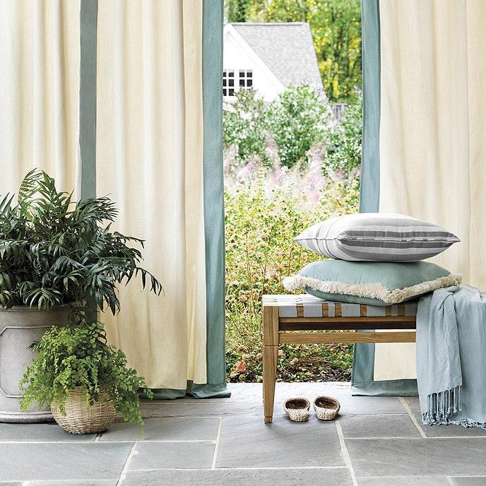 "Made from extra thick Sunbrella fabric, these tailored drapes are resistant to fading—no matter how much sunlight they're up against. Though the warm beige base color may feel a bit traditional, the wide border (which is available in five stylish shades) adds a more contemporary feel. Did we mention they're super easy to hang, thanks to two-inch nickel grommets and weighted corners? $169, Ballard Designs. <a href=""https://www.ballarddesigns.com/indoor-2foutdoor-framed-panel/rugs-drapery/drapery/pattern/381520?"" rel=""nofollow noopener"" target=""_blank"" data-ylk=""slk:Get it now!"" class=""link rapid-noclick-resp"">Get it now!</a>"
