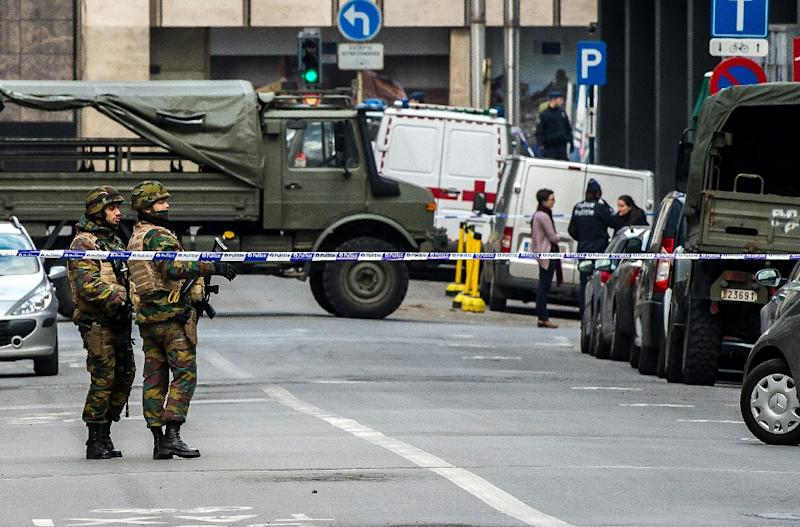 Belgian soldiers cordon off roads leading to the Maalbeek metro station in Brussels, on March 22, 2016