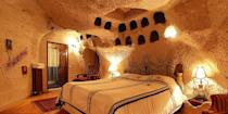 """<p>Make like the Flintstones and spend the night in a cave! Turkey's <a href=""""https://www.bestproducts.com/fun-things-to-do/g2713/most-beautiful-places-in-the-world/"""" rel=""""nofollow noopener"""" target=""""_blank"""" data-ylk=""""slk:Cappadocia"""" class=""""link rapid-noclick-resp"""">Cappadocia</a> region is known throughout the world for its extensive cave systems, and there are several hotels, such as <a href=""""https://go.redirectingat.com?id=74968X1596630&url=https%3A%2F%2Fwww.tripadvisor.com%2FHotel_Review-g297983-d298393-Reviews-Cappadocia_Cave_Suites-Goreme_Cappadocia.html&sref=https%3A%2F%2Fwww.elledecor.com%2Flife-culture%2Fg37430670%2Funique-unusual-hotels-in-the-world%2F"""" rel=""""nofollow noopener"""" target=""""_blank"""" data-ylk=""""slk:Cappadocia Cave Suites"""" class=""""link rapid-noclick-resp"""">Cappadocia Cave Suites</a> (shown here) and <a href=""""https://go.redirectingat.com?id=74968X1596630&url=https%3A%2F%2Fwww.tripadvisor.com%2FHotel_Review-g297983-d298402-Reviews-Kelebek_Special_Cave_Hotel-Goreme_Cappadocia.html&sref=https%3A%2F%2Fwww.elledecor.com%2Flife-culture%2Fg37430670%2Funique-unusual-hotels-in-the-world%2F"""" rel=""""nofollow noopener"""" target=""""_blank"""" data-ylk=""""slk:Kelebek Special Cave Hotel"""" class=""""link rapid-noclick-resp"""">Kelebek Special Cave Hotel</a>, constructed in and around these rock formations. Many of these subterranean rooms feature ancient archways and natural wall recesses. </p>"""
