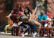 """This image released by Warner Bros. Entertainment shows Dascha Polanco, from left, Daphne Rubin-Vega and Stephanie Beatriz in a scene from """"In the Heights."""" (Macall Polay/Warner Bros. Entertainment via AP)"""