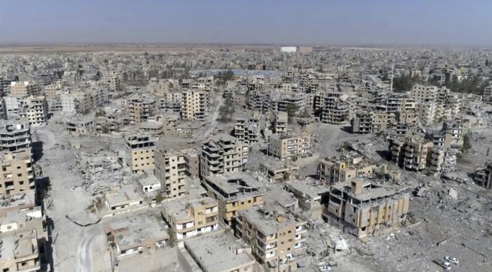 FILE - In this Thursday, Oct. 19, 2017 file photo, a frame grab made from drone video shows damaged buildings in Raqqa, Syria.(AP Photo/Gabriel Chaim, File)