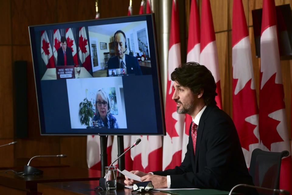 Canadian Prime Minister Justin Trudeau holds a press conference as he is joined virtually by ministers and government officials in Ottawa, Ontario, on Friday, Feb. 26, 2021, to provide an update on the COVID-19 pandemic and vaccine roll-out in Canada. (Sean Kilpatrick/The Canadian Press via AP)