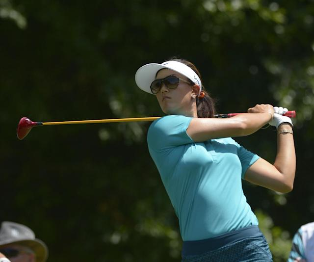 Michelle Wie hits her tee shot on the fifth hole in the second round of the Airbus LPGA Classic golf tournament at Magnolia Grove on Friday, May 23, 2014, in Mobile, Ala. (AP Photo/G.M. Andrews)