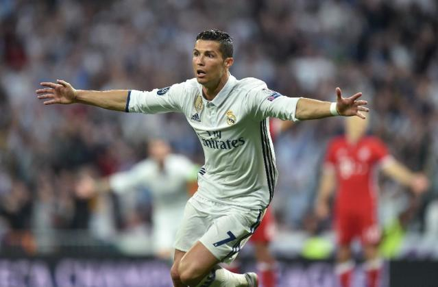 Real Madrid's striker Cristiano Ronaldo celebrates after his second goal during the UEFA Champions League quarter-final second leg football match Real Madrid vs FC Bayern Munich at the Santiago Bernabeu stadium in Madrid in Madrid on April 18, 2017 (AFP Photo/Christof STACHE)