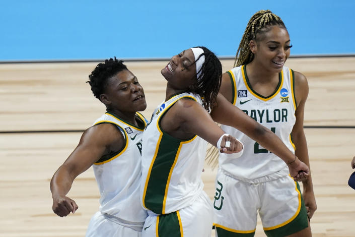 Baylor guard Moon Ursin, left, celebrates with teammate forward NaLyssa Smith during the second half of a college basketball game against Jackson State in the first round of the women's NCAA tournament at the Alamodome, Sunday, March 21, 2021, in San Antonio. (AP Photo/Eric Gay)