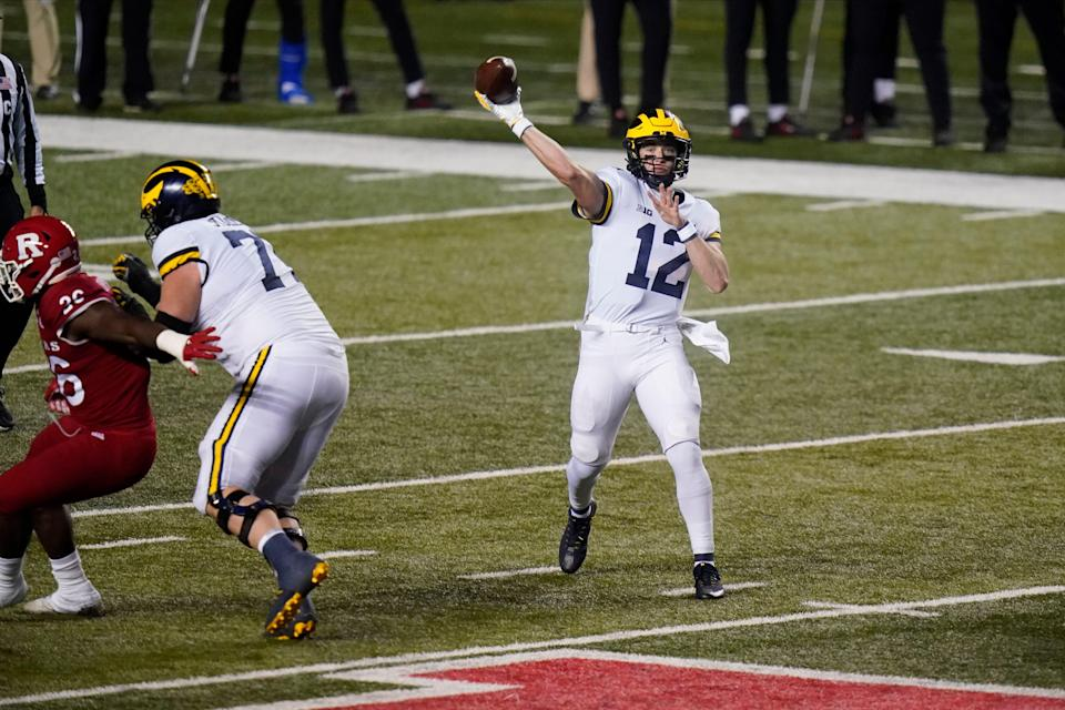 Michigan's Cade McNamara throws a pass during the second half of the team's NCAA football game against Rutgers on Saturday, Nov. 21, 2020, in Piscataway, N.J. Michigan won 48-42.