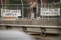 """Signs that read """"Black Lives Matter"""" and """"Stop Killing Black People"""" hang on an overpass on North Capitol Street in Washington, Tuesday, June 2, 2020, following days of continuing protests over the death of George Floyd. Floyd died after being restrained by Minneapolis police officers. (AP Photo/Andrew Harnik)"""