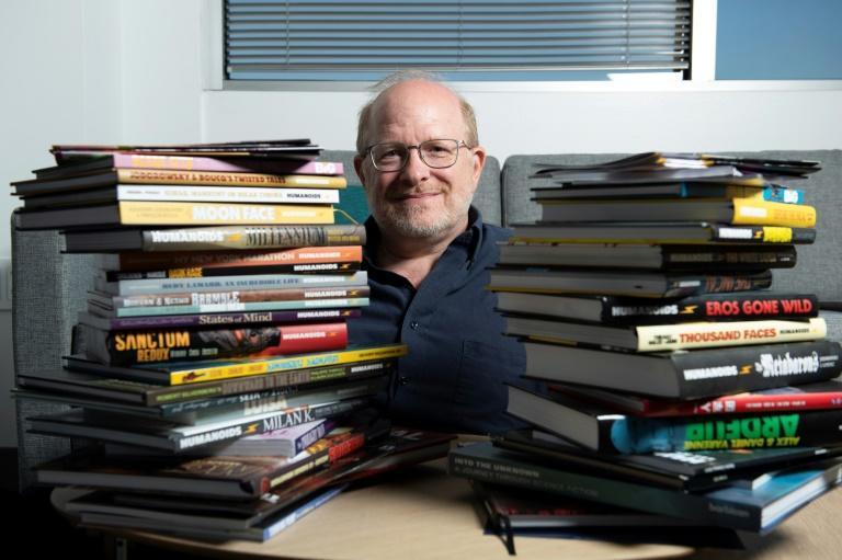 """US comic book writer Mark Waid said the characters in his stories are """"dealing with things on a more realistic and a more human level"""" (AFP Photo/VALERIE MACON)"""