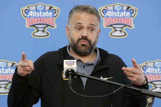FILE - In this Dec. 27, 2019, file photo, Baylor head coach Matt Rhule takes questions from the media as his team arrives for the Sugar Bowl NCAA college football game against Georgia at Louis Armstrong International Airport, in New Orleans. A person familiar with the situation says the Carolina Panthers are completing a contract to hire Baylor's Matt Rhule as their coach. The person spoke to The Associated Press on Tuesday, Jan. 7, 2020, on condition of anonymity because the deal is not done. The Panthers have not spoken publicly about the coaching search. (Curtis Compton/Atlanta Journal-Constitution via AP, File)