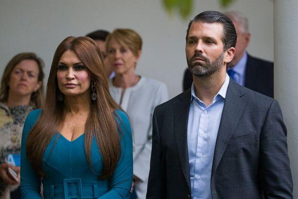 PHOTO: In this July 11, 2019, file photo, Donald Trump Jr., the son of President Donald Trump, right, and his girlfriend Kimberly Guilfoyle, listen as President Donald Trump speaks about the 2020 census in the Rose Garden of the White House in Washington. (Alex Brandon/AP, File)