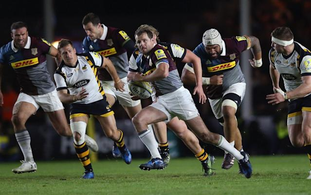 Nick Evans, who kicked 22 points on his final home match for Harlequins, makes a break - Getty Images Europe