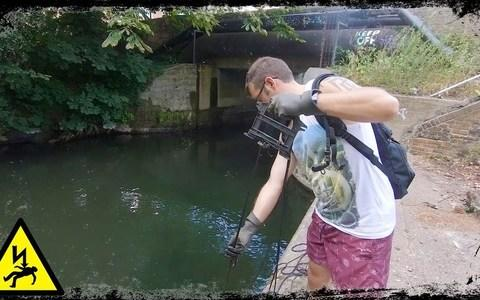 Gareth Bryer magnet fishing in Enfield Lock, London  - Credit: Gareth Bryer / Triangle News
