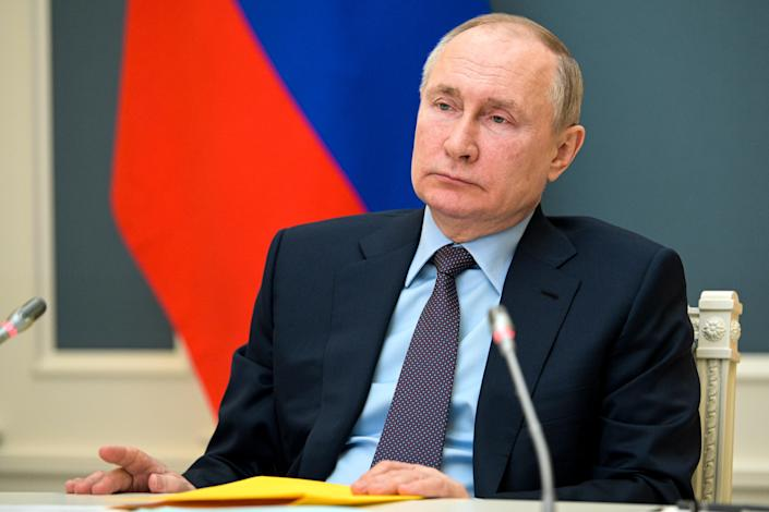 <p>Vladimir Putin attends a session of the Russian Geographical Society in Moscow, Russia on 14 April 2021.</p> (AP)