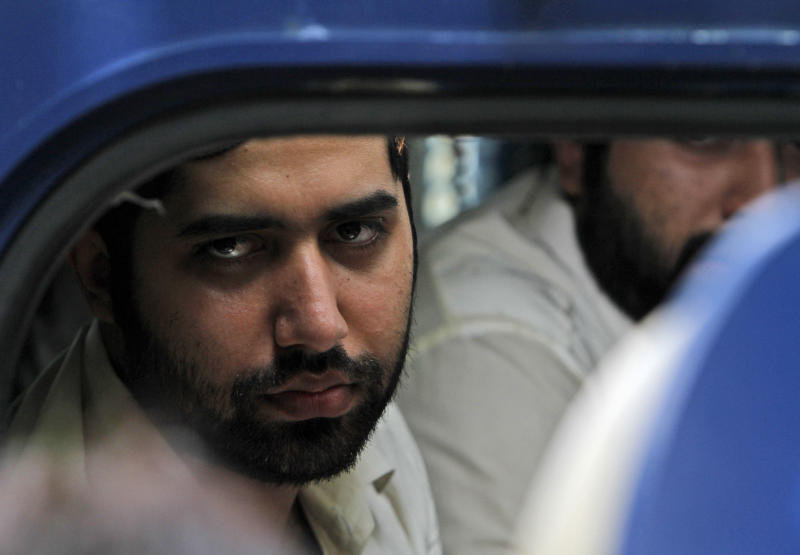 Nawab Siraj Talpur, convicted of killing 20-year-old Shahzeb Khan, looks out a police vehicle outside an Anti-Terrorism court in Karachi, Pakistan, Friday, June 7, 2013. Talpur and Shahrukh Jatoi received death sentences Friday over a fatal shooting that exposed class divisions in Pakistan and led to an unusual social media campaign demanding that the country's rich and powerful be held accountable. (AP Photo/Shakil Adil)
