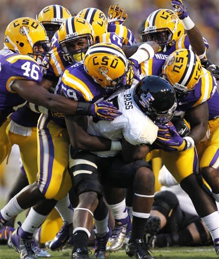 Idaho running back Ryan Bass (5) is stopped for a 2-yard loss on a fourth down carry in the first half of their NCAA college football game against LSU in Baton Rouge, Saturday, Sept. 15, 2012. (AP Photo/Gerald Herbert)