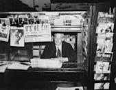 <p>A publication at a newsstand in America announces the German surrender.</p>