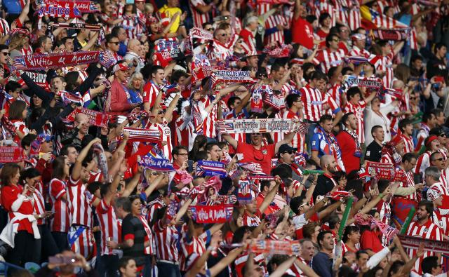Atletico Madrid supporters react before their Champions League final soccer match against Real Madrid at a fan zone at Vicente Calderon stadium in Madrid May 24, 2014. Atletico Madrid and Real Madrid play their Champions League final soccer match in Lisbon. REUTERS/Andrea Comas (SPAIN - Tags: SPORT SOCCER)