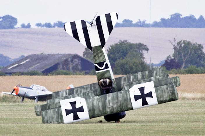 This misfortunate pilot landed his vintage tri-plane on its nose. The man had been flying the famous Fokker Dreidecker aircraft at the Flying Legends airshow at the Imperial War Museum in Duxford, Cambsridgeshire. But when he landed the WW1 fighter aircraft a sudden gust of wind blew it on its nose. No one was hurt in the incident. (Philip Tyler / Rex)