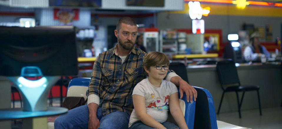 "This image released by Apple shows Justin Timberlake, left, and Ryder Allen in a scene from ""Palmer."" (Apple via AP)"