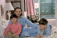 <p>Vanderbilt and her sons pose on her bed in their apartment in the UN Towers in New York.</p>
