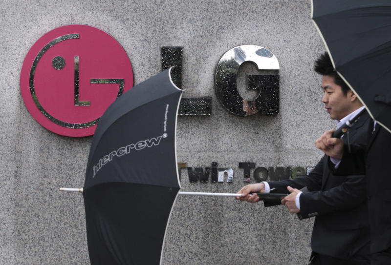 A South Korean man walks by a logo of LG Electronics Inc. in front of the company's headquarters in Seoul, South Korea, Wednesday, April 25, 2012. LG Electronics Inc. posted its first profit in three quarters, beating expectations thanks to a revival in its mobile business and demand for high-end TVs. (AP Photo/Ahn Young-joon)