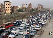 FILE PHOTO: Cars are stuck in a traffic jam before hours of curfew to contain the spread of the coronavirus disease (COVID-19), in Cairo