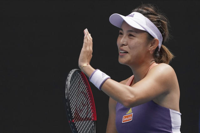 China's Wang Qiang celebrates after defeating Serena Williams of the U.S. in their third round singles match at the Australian Open tennis championship in Melbourne, Australia, Friday, Jan. 24, 2020. (AP Photo/Lee Jin-man)