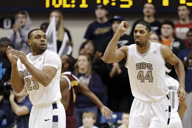 FILE - In this Feb. 5, 2013, file photo, Akron's Zeke Marshall (44) celebrates a play with Chauncey Gilliam (23) in an NCAA college basketball game against Central Michigan in Akron, Ohio. InIn a season of parity that has produced quite a few surprises, a few of the unexpected turns, such as Akron's success, have stood out. (AP Photo/Mark Duncan, File)