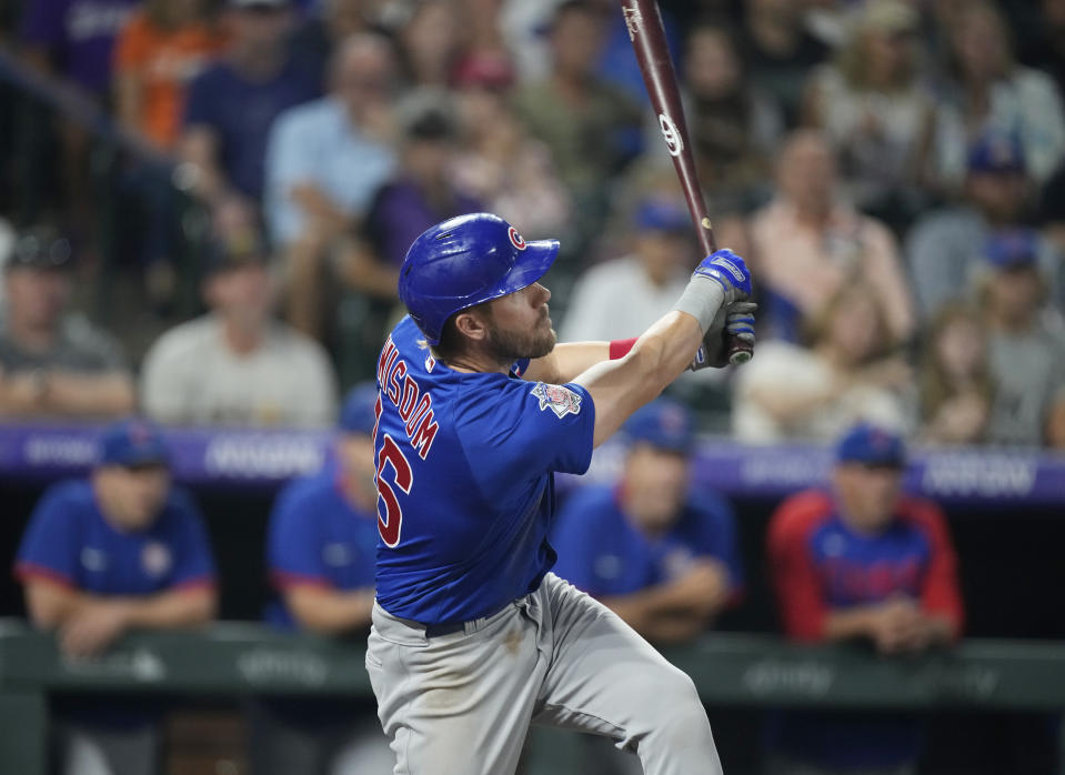 Chicago Cubs' Patrick Wisdom follows the flight of his double to drive in three runs off Colorado Rockies starting pitcher Jon Gray in the fifth inning of a baseball game Wednesday, Aug. 4, 2021, in Denver. (AP Photo/David Zalubowski)