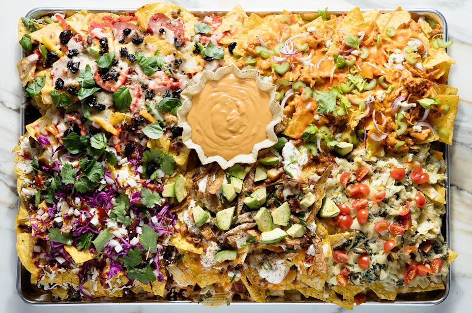 "Okay, you don't actually need to go wild with all 50 ingredients. You can choose just one of the (much-simpler) five ""zones"" to make for game day. <a href=""https://www.epicurious.com/recipes/food/views/epis-50-ingredient-super-bowl-nachos?mbid=synd_yahoo_rss"" rel=""nofollow noopener"" target=""_blank"" data-ylk=""slk:See recipe."" class=""link rapid-noclick-resp"">See recipe.</a>"