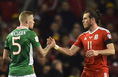 Football Soccer - Republic of Ireland v Wales - 2018 World Cup Qualifying European Zone - Group D - Aviva Stadium, Dublin, Republic of Ireland - 24/3/17 Wales' Gareth Bale and Republic of Ireland's James McClean after the match Reuters / Clodagh Kilcoyne Livepic