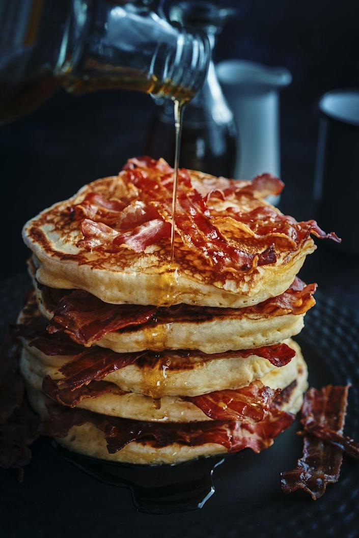 """<p>Is there a better combo than pancakes and bacon? You don't even need a recipe for this ideas—just layer slices of crispy bacon between flapjacks. And drizzle with some syrup, of course!</p><p><a class=""""link rapid-noclick-resp"""" href=""""https://go.redirectingat.com?id=74968X1596630&url=https%3A%2F%2Fwww.walmart.com%2Fip%2FGotham-Steel-Bacon-Bonanza-XL-18-Slice-Nonstick-Copper-2-Piece-Set-Includes-Bacon-Cooker-and-Drip-Tray%2F186296923&sref=https%3A%2F%2Fwww.thepioneerwoman.com%2Ffood-cooking%2Fmeals-menus%2Fg36146701%2Fbest-pancake-toppings%2F"""" rel=""""nofollow noopener"""" target=""""_blank"""" data-ylk=""""slk:SHOP BACON COOKERS"""">SHOP BACON COOKERS</a></p>"""
