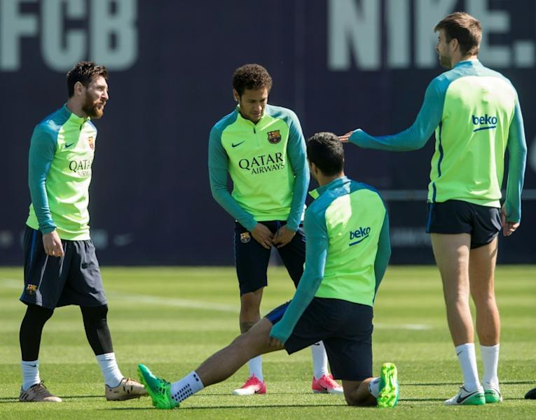 Barcelona's Lionel Messi (L) chats with teammate Neymar (2ndL) and Gerard Pique (R) during a training session at the Sports Center FC Barcelona Joan Gamper in Sant Joan Despi, near Barcelona, on April 22, 2017