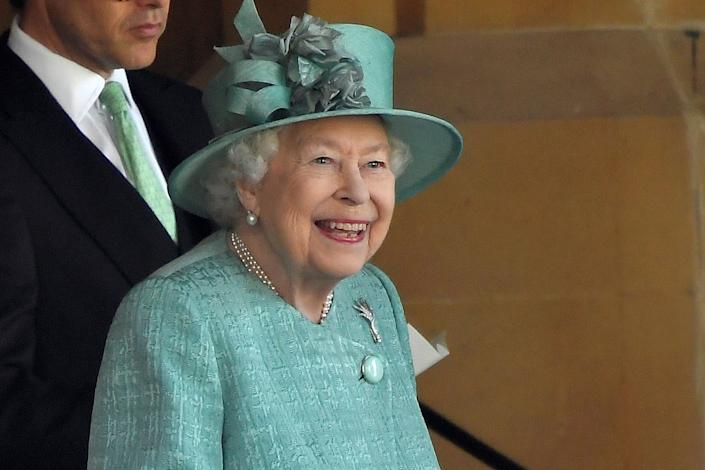 WINDSOR, ENGLAND - JUNE 13:  Queen Elizabeth II attends a ceremony to mark her official birthday at Windsor Castle on June 13, 2020 in Windsor, England. The Queen celebrates her 94th birthday this year, in line with Government advice, it was agreed that The Queen's Birthday Parade, also known as Trooping the Colour, would not go ahead in its traditional form. (Photo by Toby Melville - WPA Pool/Getty Images)