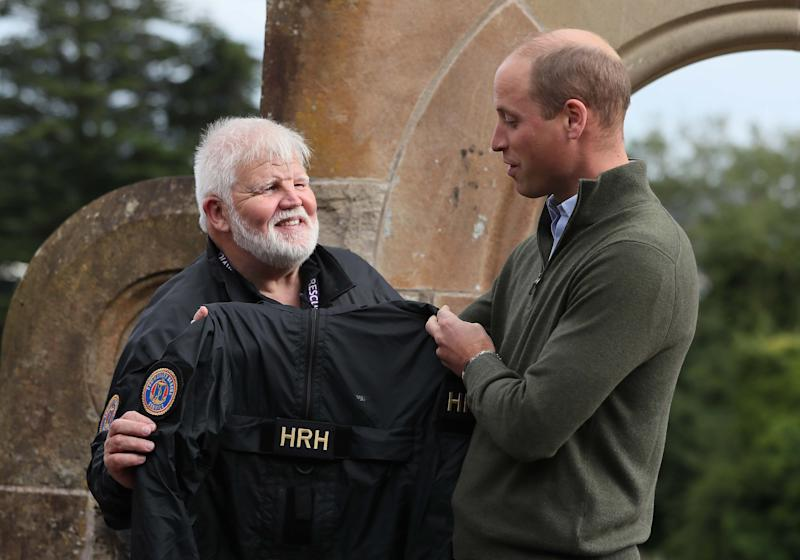 BELFAST, NORTHERN IRELAND - SEPTEMBER 09: Prince William, Duke of Cambridge (right)speaks with Community Rescue Service (CRS) founder and regional commander Sean McCarry during a visit to the CRS at Cave Hill Country Park as part of his tour of Belfast on September 9, 2020 in Belfast, Northern Ireland. (Photo by Brian Lawless - WPA Pool/Getty Images)