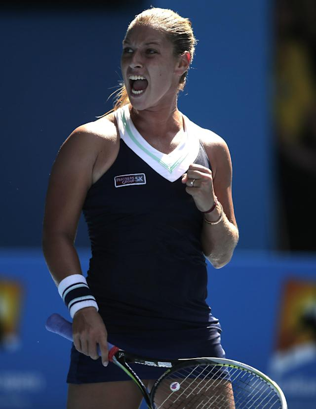 Dominika Cibulkova of Slovakia celebrates a point won against Agnieszka Radwanska of Poland during their semifinal at the Australian Open tennis championship in Melbourne, Australia, Thursday, Jan. 23, 2014.(AP Photo/Rick Rycroft)
