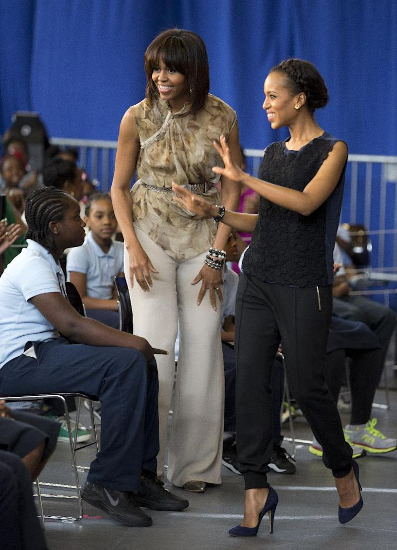 First lady Michelle Obama and actress Kerry Washington smile as they arrive for a performance at Savoy Elementary School in Washington, Friday, May 24, 2013. The Savoy School was one of eight schools selected last year for the Turnaround Arts Initiative at the President's Committee on the Arts and Humanities. Turnaround Arts Schools use the arts as a central part of their reform strategy to improve low performing schools (AP Photo/Evan Vucci)