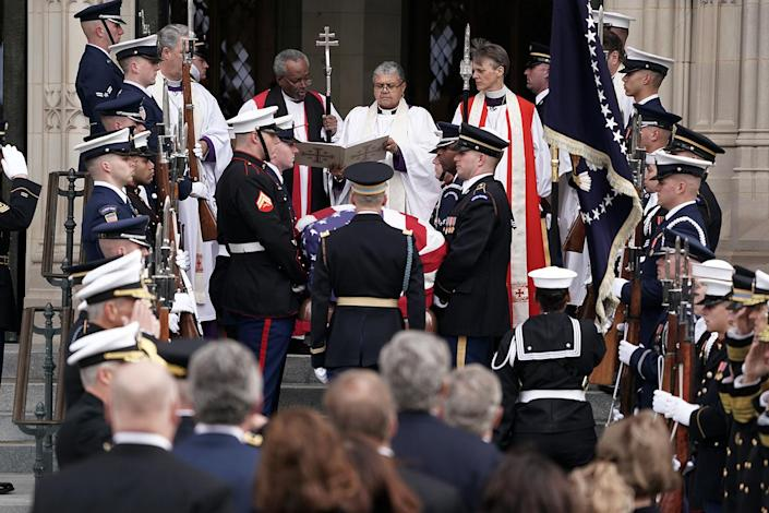 A joint service honor guard carries the casket of former President George H.W. Bush into the Washington National Cathedral for a state funeral on Dec. 5, 2018 in Washington, D.C. (Photo: Alex Wong/Getty Images)