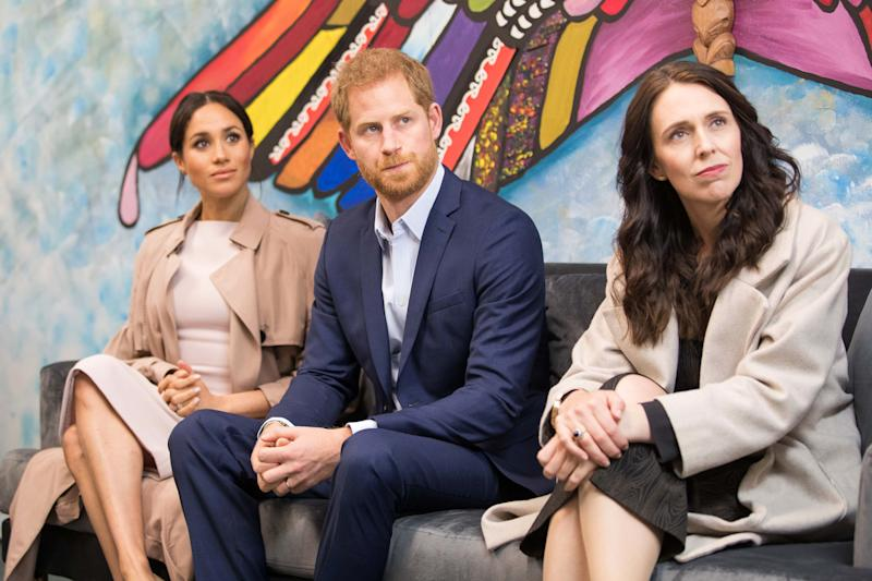 """Britain's Prince Harry and his wife Meghan, the Duchess of Sussex join New Zealand's Prime Minister Jacinda Ardern (R) on a visit to Pillars, a charity operating across New Zealand that supports children who have a parent in prison by providing special mentoring schemes, in Manukau City in Auckland on October 30, 2018. - Meghan Markle displayed an unexpected talent for """"welly wanging"""" in Auckland on October 30, gaining bragging rights over husband Prince Harry after they competed in the oddball New Zealand sport. (Photo by JASON DORDAY / POOL / AFP) (Photo credit should read JASON DORDAY/AFP via Getty Images)"""