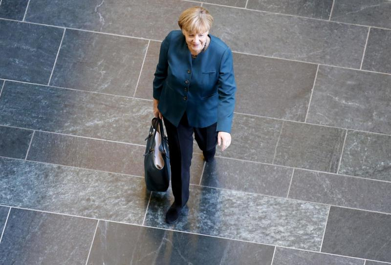 German Chancellor and leader of the Christian Democratic Union (CDU) Angela Merkel arrives for a meeting of senior party leaders before preliminary talks between Germany's conservative (CDU/CSU) parties and the Social Democrats (SPD) in Berlin October 4, 2013. The SPD are seen as the conservative chancellor's most likely partner, but they have said they will not be rushed into a deal. Merkel will also hold preliminary talks with the Greens next week, playing potential partners off against each other. REUTERS/Fabrizio Bensch (GERMANY - Tags: POLITICS TPX IMAGES OF THE DAY)