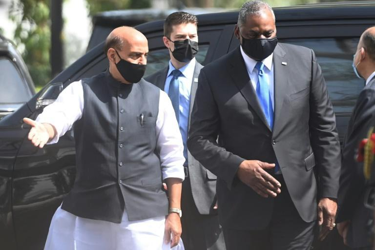US Defense Secretary Lloyd Austin (R) speaks with Indian Defence Minister Rajnath Singh as he arrives to inspect the guard of honour in New Delhi