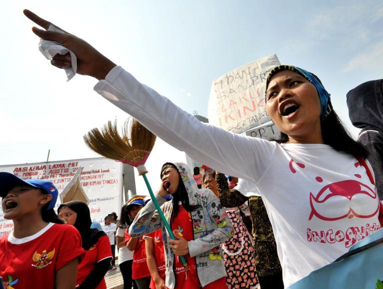 Women shout slogans during a rally in Jakarta on August 2, 2009 demanding the Indonesian government to protect overseas maids and migrant workers from abuse