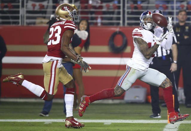 New York Giants wide receiver Odell Beckham Jr., right, catches a touchdown pass in front of San Francisco 49ers cornerback Ahkello Witherspoon (23) during the second half of an NFL football game in Santa Clara, Calif., Monday, Nov. 12, 2018. (AP Photo/Ben Margot)