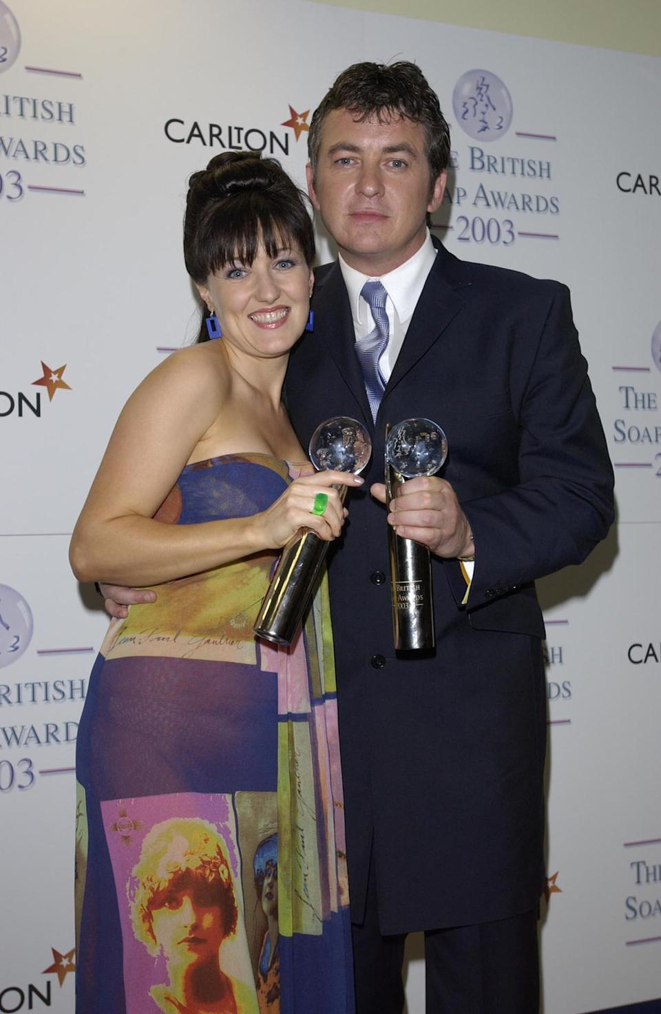 LONDON - MAY 10:  Television soap stars Kasey Ainsworth and Shane Richie in the press room at BBC Television Centre in West London on May 10, 2003 after the 5th Annual British TV Soap Awards. Ainsworth won the Best Actress award for her part as Little Mo in Eastenders, Richie won Sexiest Male. (Photo by Steve Finn/Getty Images)
